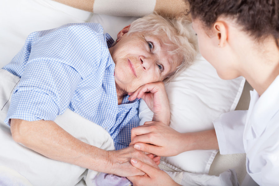 featured image showing a young person caring for an elder