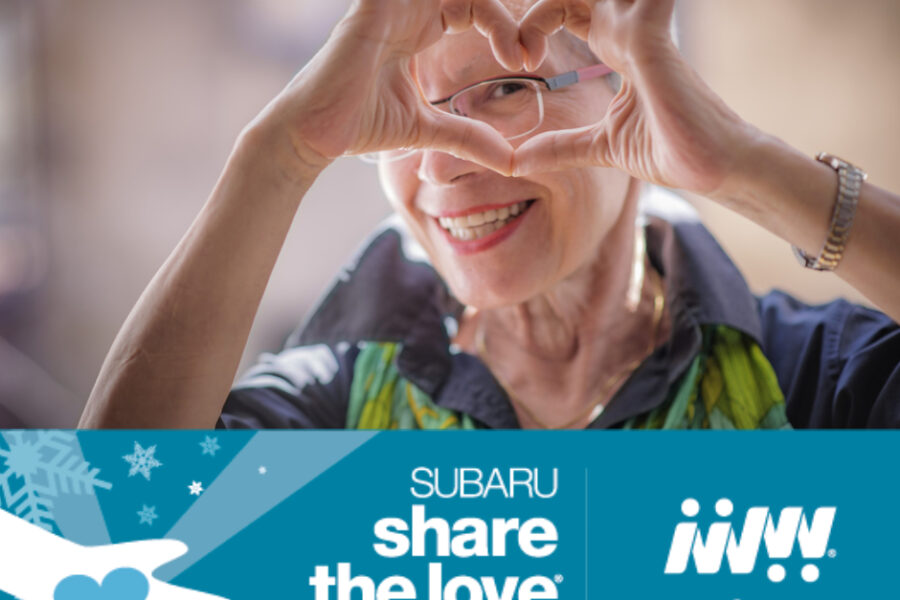 featured image showing a happy elderly woman making a heart shape with her fingers while smiling.